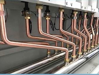 Poza Centrala termica electrica cu inductie OFS-DTL 160 kW - detaliu cu conductele de agent termic
